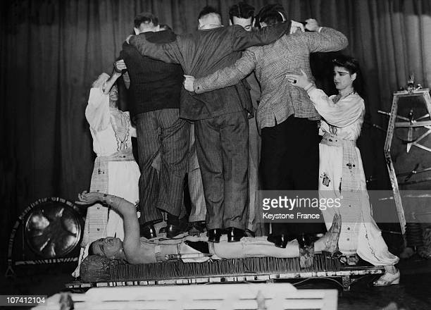 Six People Standing On A Man Lied On A Bed Of Nails Fakir Performance At Colwyn Bay In Wales On October 1947
