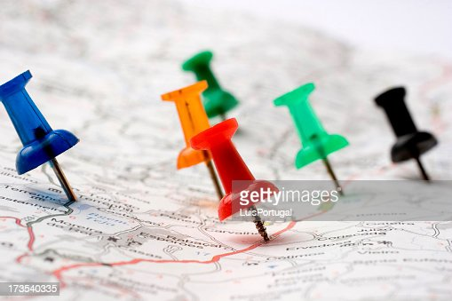 Six pins pointed on several spots on a road map