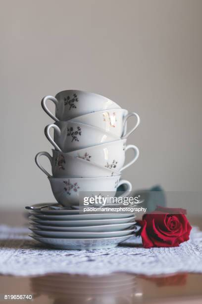 Six teacups stacked on six saucers
