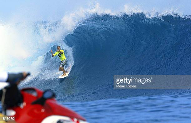 Six times ASP world champion Kelly Slater of Florida USA claims his perfect 10 points tube ride during round three of the Quiksilver Pro at...