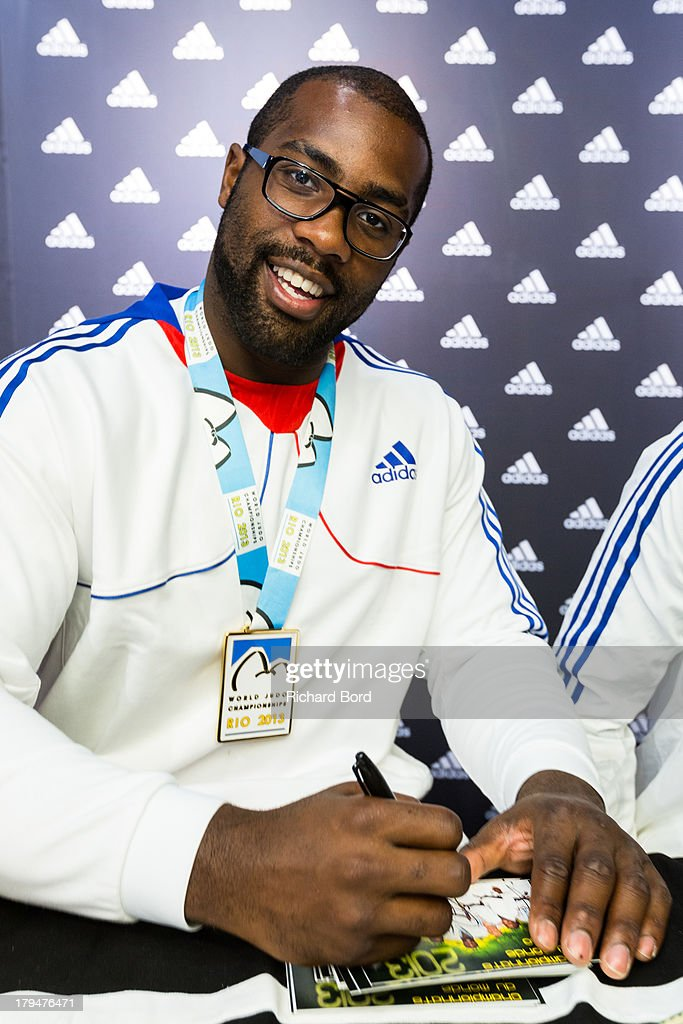 Six times Judo World Champion <a gi-track='captionPersonalityLinkClicked' href=/galleries/search?phrase=Teddy+Riner&family=editorial&specificpeople=4114927 ng-click='$event.stopPropagation()'>Teddy Riner</a> of France signs an autograph at Adidas Performance Store Champs-Elysees on September 4, 2013 in Paris, France.