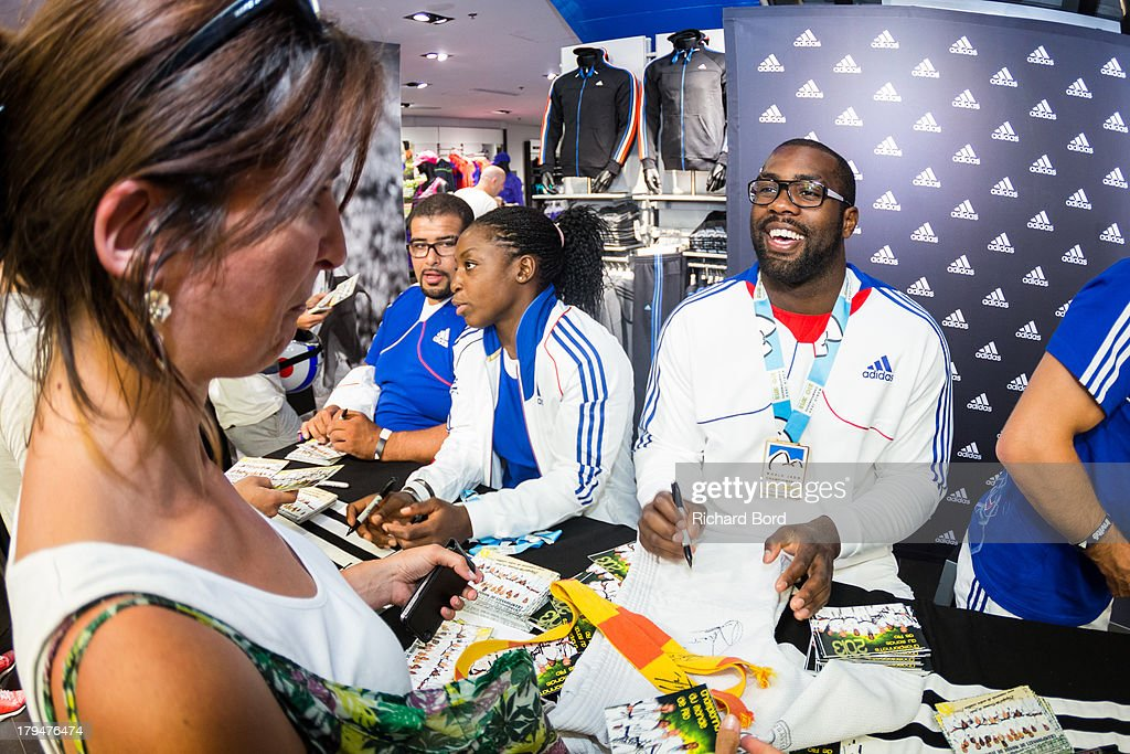 Six times Judo World Champion, <a gi-track='captionPersonalityLinkClicked' href=/galleries/search?phrase=Teddy+Riner&family=editorial&specificpeople=4114927 ng-click='$event.stopPropagation()'>Teddy Riner</a> of France signs an autograph at Adidas Performance Store Champs-Elysees on September 4, 2013 in Paris, France.