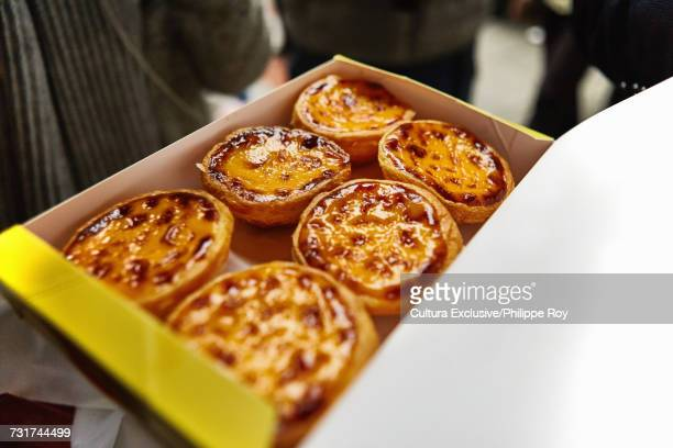 Six traditional egg tarts in carton, Macau
