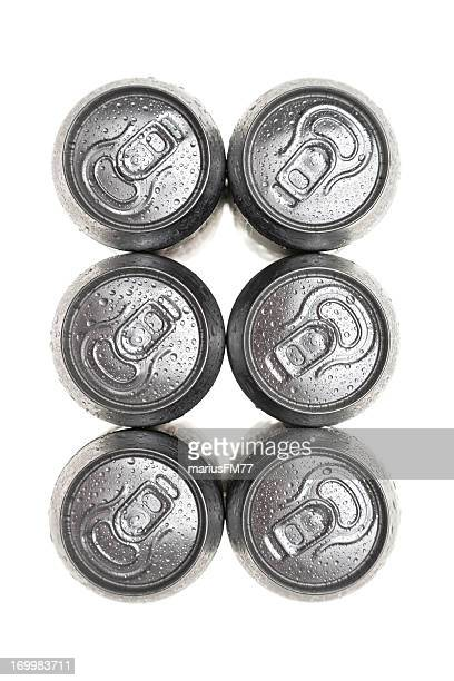 six wet aluminium drink cans