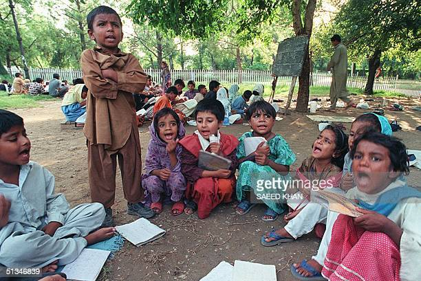 A six year old child of an open air school in Pakistan capital Islamabad is keeping his classmates busy in revising lessons in the absence of his...