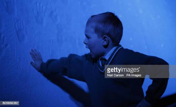 Six year old Jack Kelly from Lucan touches a mock iceberg at a preview of Titanic the Artifact exhibition which runs at the the Citywest event centre...