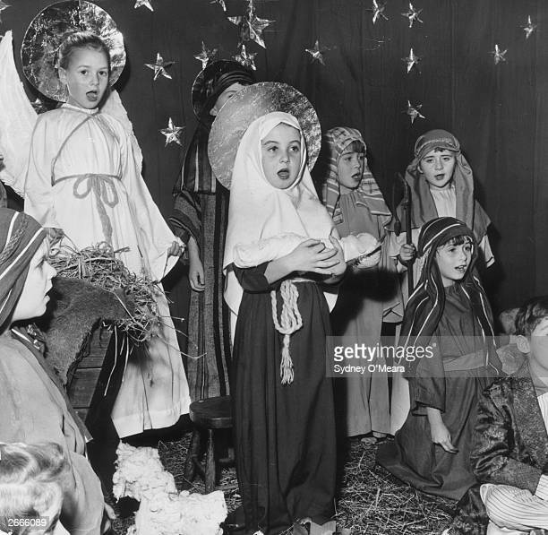Six year old Sharon Harwood playing Mary during a dress rehearsal of a nativity play at St Matthew's school in Ponders End London