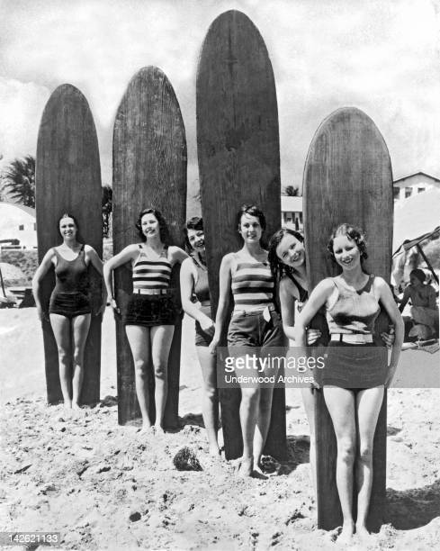 Six young women are ready with their surf boards on a beach in southern California Southern California late 1920s or early 1930s
