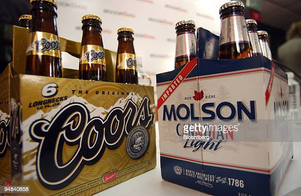 A sixpack of Coors original beer sits next to a sixpack of Molson's beer at a press conference at the Coors brewery Tuesday February 1 in Golden...