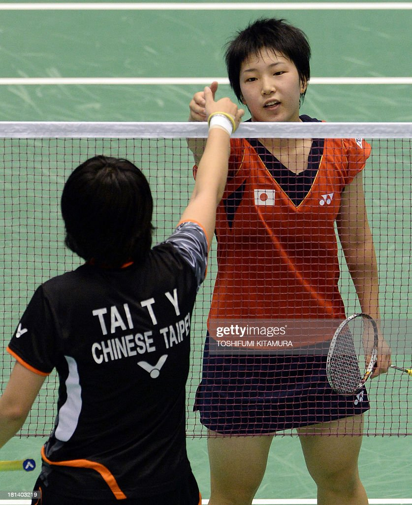 Sixteen year old Akane Yamaguchi of Japan R is congratulated by