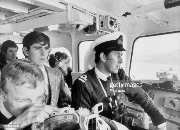 Sixteenyearold Prince Andrew during a trip aboard his Royal brother's ship HMS Bronington off the coast of Scotland He is flanked by his brother the...