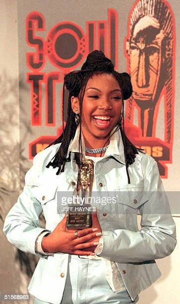 Sixteenyearold singer Brandy holds the award she received at the ninth annual Soul Train Music Awards 13 March at the Shrine Auditorium in Los...