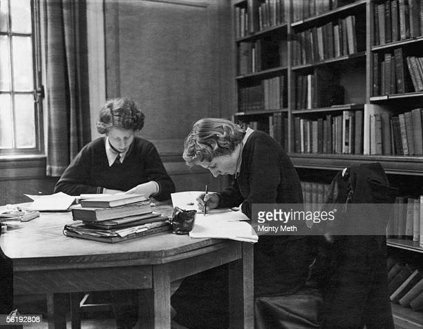 Sixth form pupils at work in the library at Christ's Hospital girls' school in Hertford 3rd March 1953