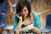 A sixth Form student uses her mobile phone after she has opened her Alevel results at Hayesfield Girls' School on August 19 2010 in Bath England...