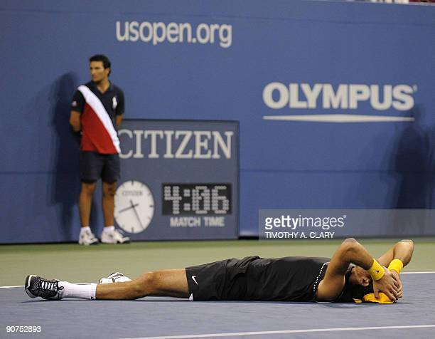Sixthseeded Argentinian Juan Martin Del Potro celebrates defeating top seed Roger Federer of Switzerland in the US Open men's final at the USTA...