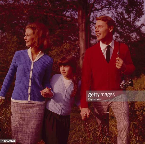 Sixties Fashion A man a woman and a young girl walk through countryside all wearing knitted cardigans in 1967