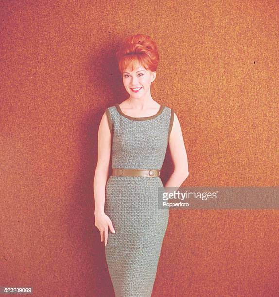 Sixties Fashion A young female model wears a grey knitted slim line sleeveless dress circa 1963
