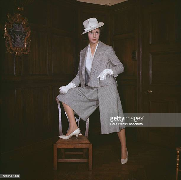 Sixties Fashion A young female model wears a 'Pankhurst' light grey skirt suit with the skirt divided to resemble baggy knee length trousers or...