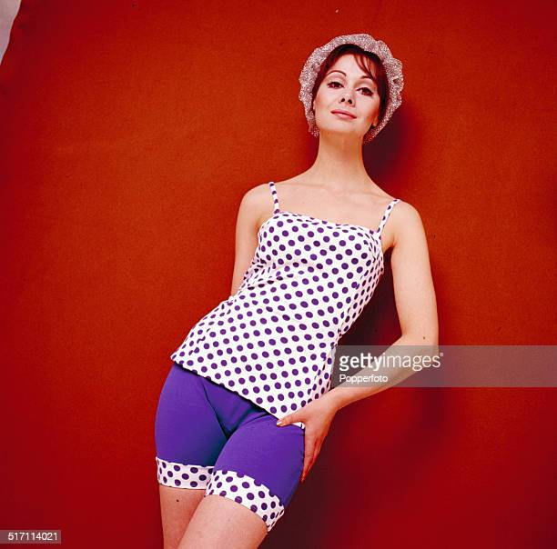 Sixties Fashion A young female model wears a purple and white polka dot top and matching purple shorts with polka dot trim circa 1965