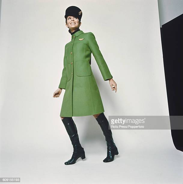 Sixties Fashion A young female model wears the new staff uniform of Alitalia The Italian national airline for cabin crew air hostesses and ground...
