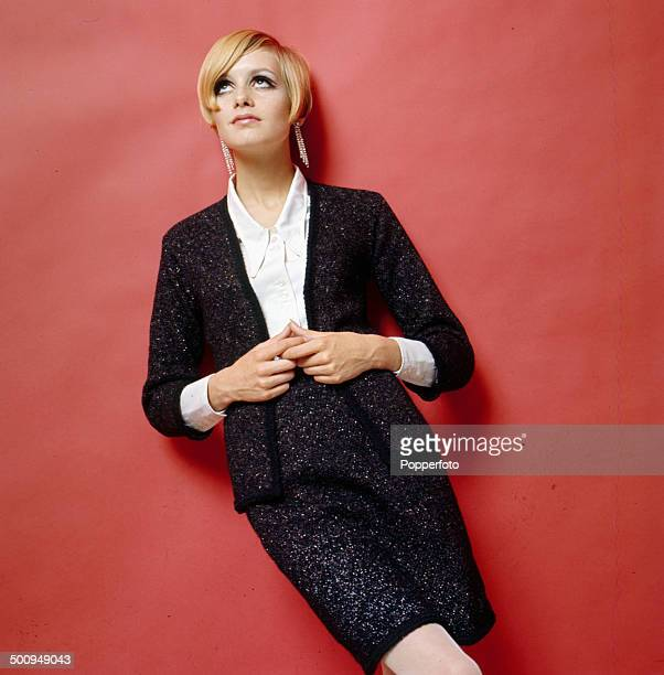 Sixties Fashion English fashion model Twiggy wears a light weight knitted two piece jacket and matching skirt over a white shirt circa 1966