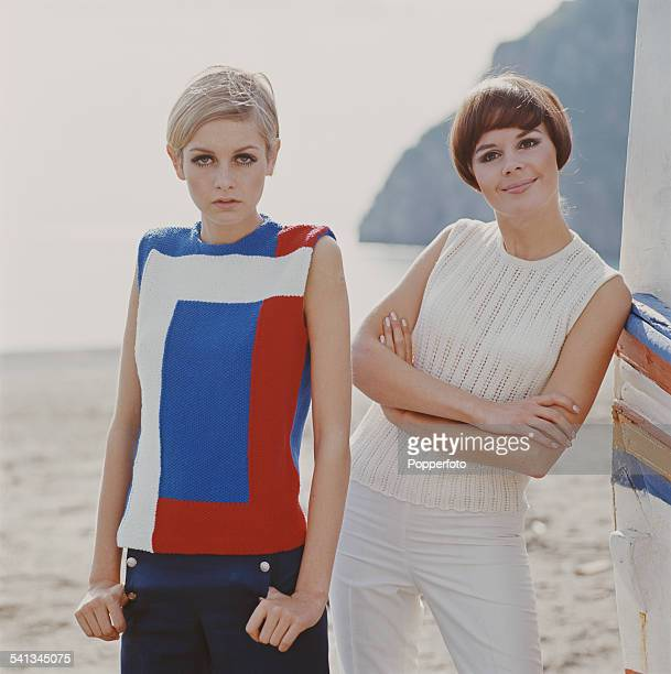 Sixties Fashion English model Twiggy and another female model wear knitted sleeveless tops in blue red and white and trousers in blue and white on a...