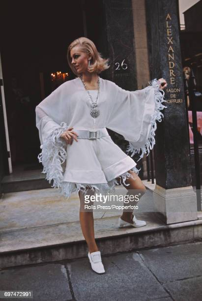 Sixties Fashion Jane a young female model wears a creation called 'What A Bloomer' white organza culottes shorts lined with white blooms along with...