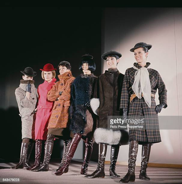 Sixties Fashion View of young female models wearing an assortment of winter coats hats and knee length leather boots by fashion designer Pierre...