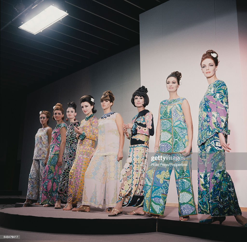 Sixties Fashion View of young female models wearing assorted highly patterned and coloured beach wear by fashion designer Emilio Pucci at the Hilton...