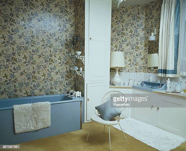 Sixties Interior Design View of the bathroom of a house featuring light blue plastic moulded bath glass splashback partially covering William Morris...