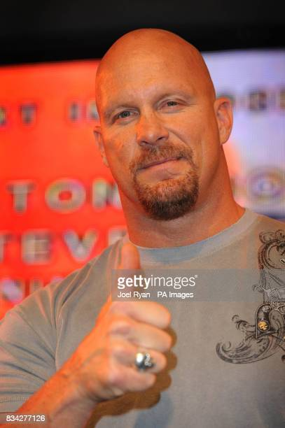 Sixtime former WWE Champion Stone Cold Steve Austin punches the air at the HMV store in central London as he promotes the release of his latest DVD...