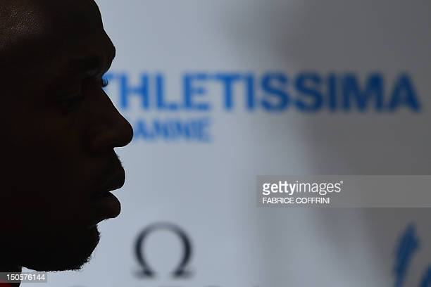 Sixtime Olympic champion Usain Bolt of Jamaica is seen in silhouette as he arrives at a press conference on the eve of the Diamond League meeting on...