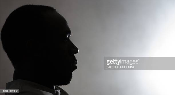 Sixtime Olympic champion Usain Bolt of Jamaica is seen in silhouette during a press conference on the eve of the Diamond League meeting on August 29...