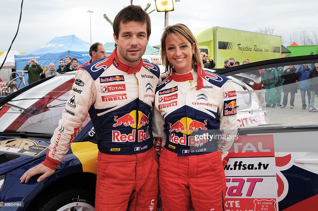 Sixtime world champion French pilot Sebastien Loeb and copilot his wife Severine Loeb pose on November 27 2009 in PortGrimaud southern France during...