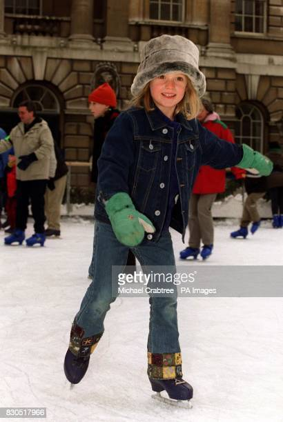 Sixyearold Chloe Hill from London joins skaters on the ice at Somerset House at the start of New Year's Eve festivities across London Somerset House...