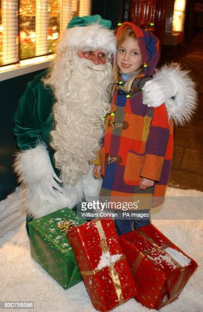 Sixyearold Emma from Skelton with a green Santa Claus in York to celebrate the launch of the UK's first ever Christmas lights to be run on clean...