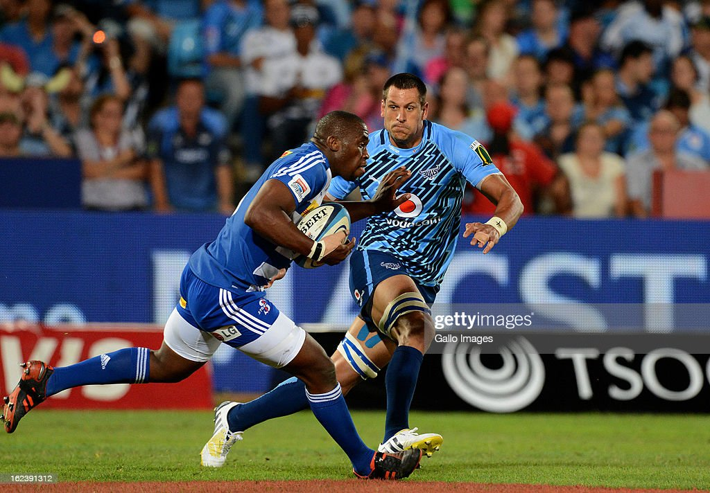 Siya Kolisi of the Stormers about to be tackled by Pierre Spies of the Bulls during the Super Rugby match between Vodacom Bulls and DHL Stormers from Loftus Versfeld Stadium on February 22, 2013 in Pretoria, South Africa.