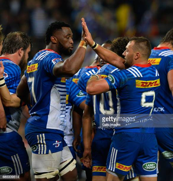 Siya Kolisi of the Stormers and Dewaldt Duvenage of the Stormers celebrate the try during the Super Rugby match between DHL Stormers and Blues at DHL...