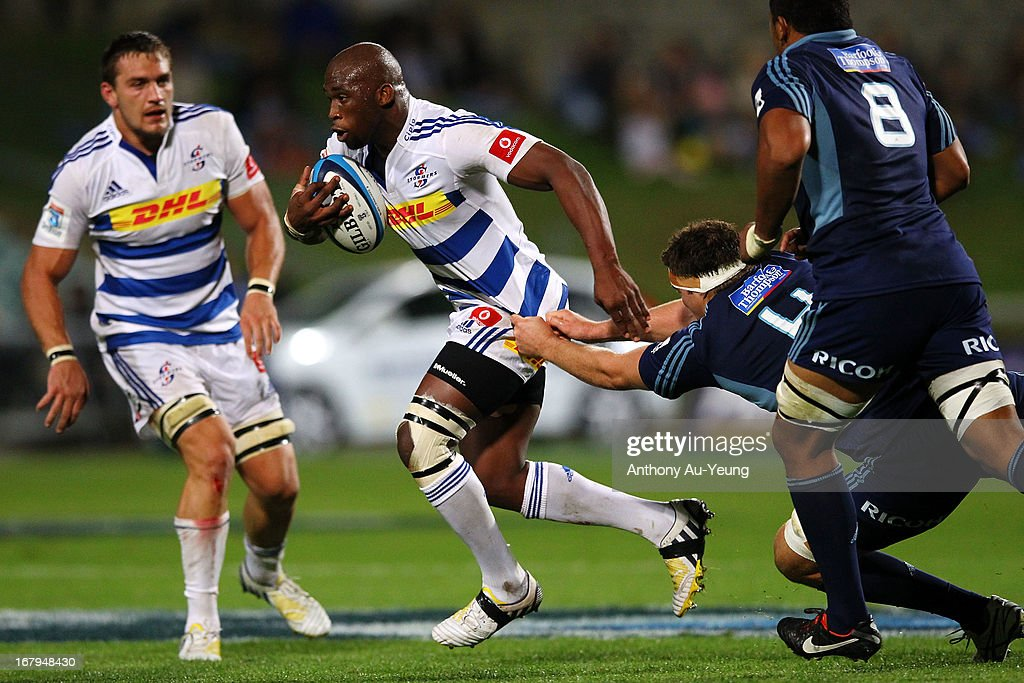 Siya Kolisi of the Stormers makes a break during the round 12 Super Rugby match between the Blues and the Stormers at North Harbour Stadium on May 3, 2013 in Auckland, New Zealand.