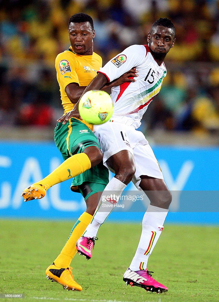 Siyabonga Sangweni of South Africa challenges Mamadou Samassa of Mali during the 2013 African Cup of Nations Quarter-Final match between South Africa and Mali at Moses Mahbida Stadium on February 02, 2013 in Durban, South Africa.