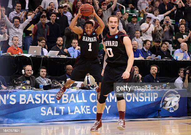 Siyani Chambers and Laurent Rivard of the Harvard Crimson celebrate as the Crimson defeat the New Mexico Lobos 6862 during the second round of the...