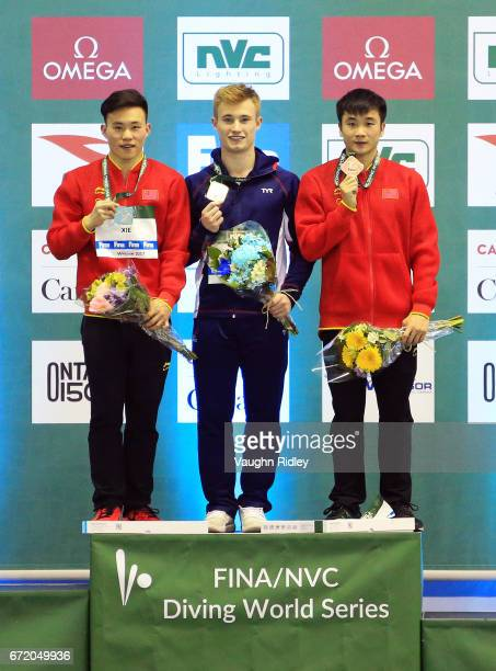 Siyi Xie of China wins Silver Jack Laugher of Great Britain wins Gold and Yuan Cao of China wins Bronze in the Men's 3m Final during the 2017 FINA...