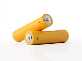 AA size two yellow batteries on white background. Horizontal composition with copy space.