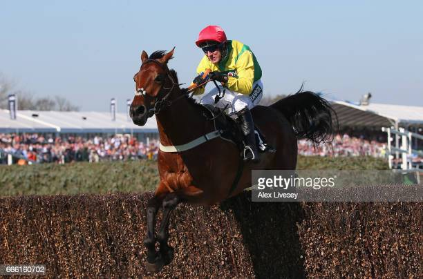 Sizing Codelco ridden by Robbie Power jumps the last fence on their way to victory in the Betway Handicap Steeple Chase at Aintree Racecourse on...