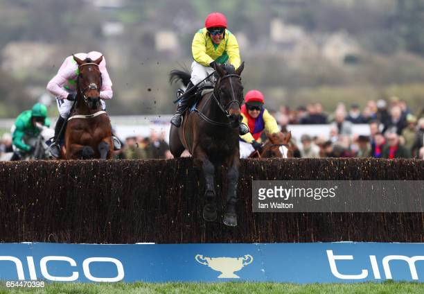Sizing John is steered to victory by Robbie Power in the Timico Cheltenham Gold Cup Chase during Gold Cup Day on day four of the Cheltenham Festival...