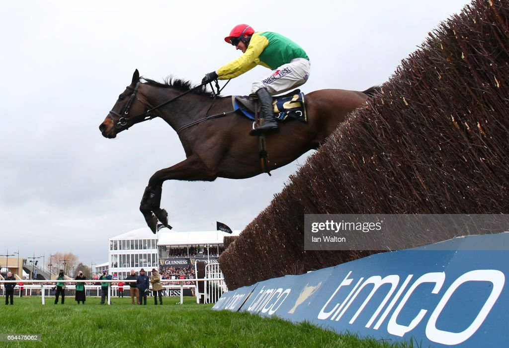Sizing John is steered to victory by Robbie Power in the Timico Cheltenham Gold Cup Chase during Gold Cup Day on day four of the Cheltenham Festival at Cheltenham Racecourse on March 17, 2017 in Cheltenham, England.