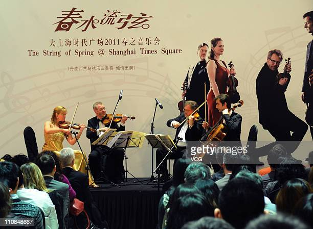 Sjaelland String Quartet of Denmark perform on the stage during 'The String of Spring @ Shanghai Times Square' series concert at Shanghai Times...