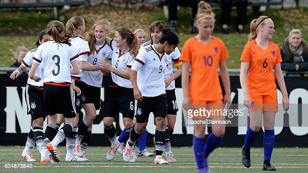 Sjoeke Nuesken of Germany celebrates with team mates after scoring her team's second goal during the U17 Girl's international friendly match between...