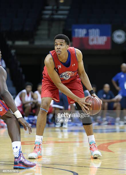 Skal Labissiere in red looks to pass the ball up the court during the National Basketball Players Association Top 100 Camp on June 17 2014 at John...