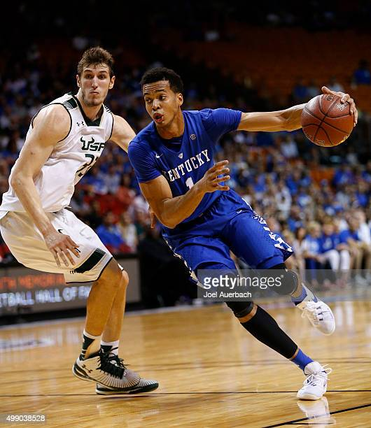 Skal Labissiere of the Kentucky Wildcats drives past Ruben Guerrero of the South Florida Bulls on November 27 2015 at the American Airlines Arena in...